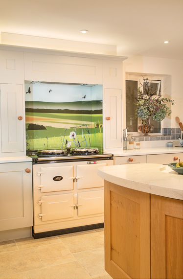 Glartique British Countryside Splashback behind AGA