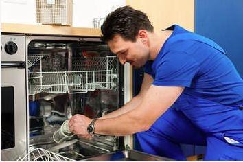 repairman fixing a dishwasher