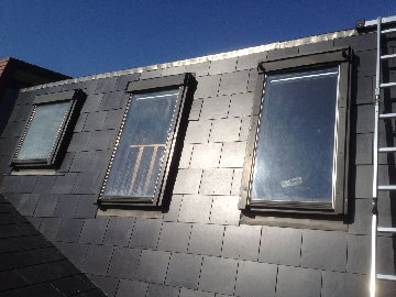 Artificial slate roofing with velux windows